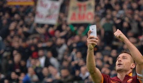 Totti celebrates derby double with 'selfie'