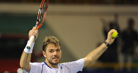 Wawrinka starts title defence with victory