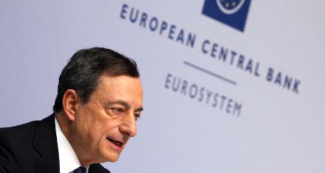 Spain bond yields hit record low