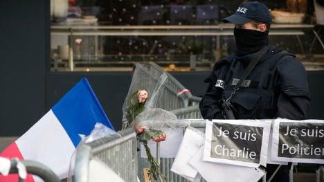 Four men charged with helping Paris gunman