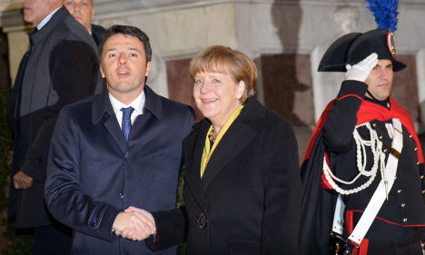 Renzi uses Florence's splendour to woo Merkel