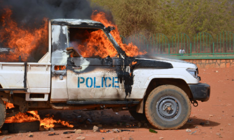 France warns citizens in riot-hit Niger