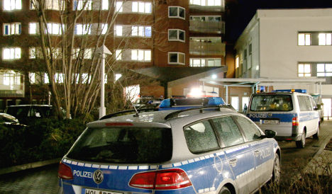 Family wound 14 police in revenge attack
