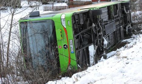 'School' bus flips over on icy road in Sweden