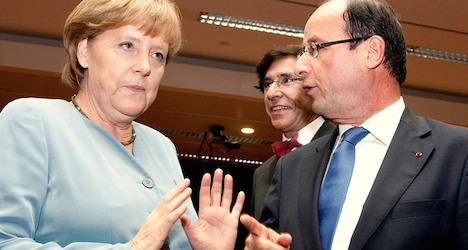 Hollande and Merkel to join Davos forum leaders