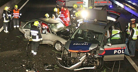 Wrong way driver crashes with police car