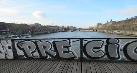 Vandals cover anti-'love lock' panels with graffiti