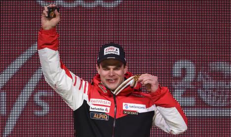 Küng wins men's world downhill title in Colorado