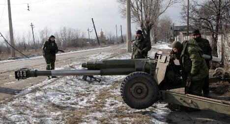 Merkel and Hollande cling to Minsk ceasefire