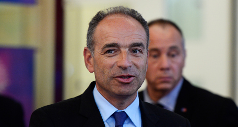 Ex-party head charged in Sarkozy finance scandal