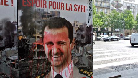 Hollande slams MPs over talks with Syria's Assad