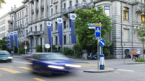Russian business sale hits Zurich's bottom line