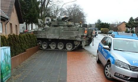 British tank crashes into family garden
