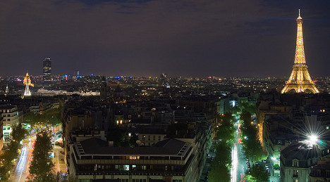 Drones fly over Paris landmarks during night