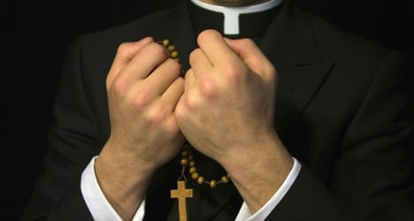 Charges dropped against 11 in priest abuse case