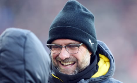 Dortmund down Freiburg to climb off bottom