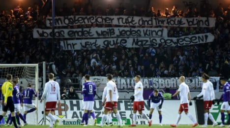 Football club condemns fans' Nazi banners