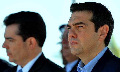 Greek PM seeks help from Hollande in Paris
