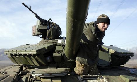 Paris hosts talks to save Ukraine peace deal