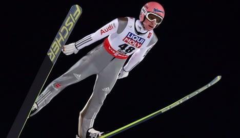 German soars into ski jump top spot