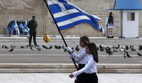 Varoufakis begs for calm in war of words