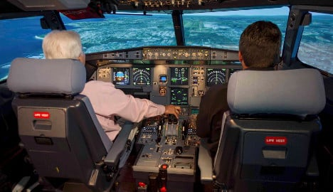 Airlines agree two-person cockpit rule