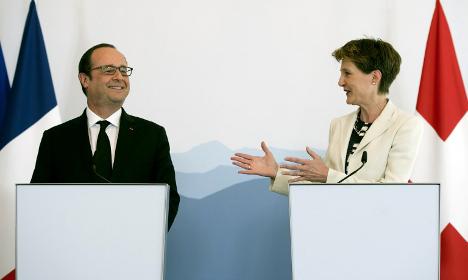 Hollande says Swiss tax squabbles 'behind us'