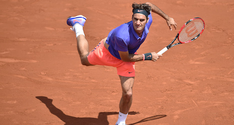 Federer and Wawrinka advance in French Open