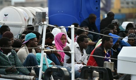 Two arrested in massive migrant cash scam