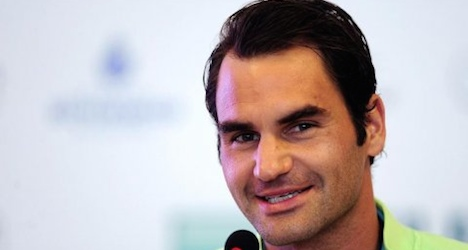 Federer beats Cuevas to advance in Italian Open