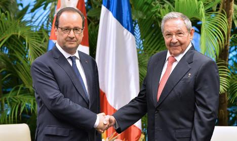 Hollande meets Castro brothers in Cuba