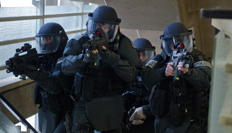 Police grab four in raids on far-right group