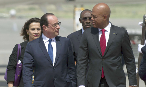 Hollande jets to Haiti for historic state visit