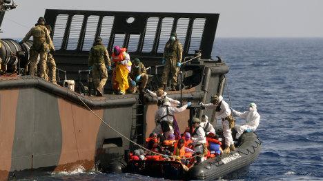 British navy ship in migrant rescue