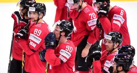 Austria helps Switzerland to hockey quarterfinals