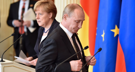 Merkel meets Putin for talks, snubs WWII parade