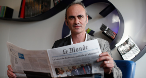 Acting director quits from France's Le Monde