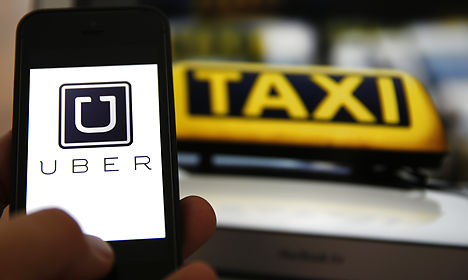 Uber charged with violating Danish law