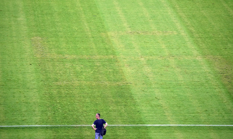 Italy complain after swastika etched on pitch