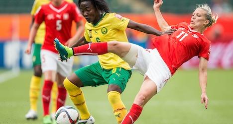 Swiss advance despite loss to Cameroon