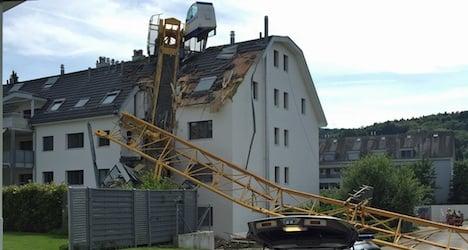 Crane collapses on apartment building