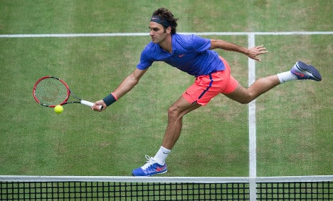 Federer revved up for Wimbledon record bid