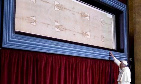 Pope venerates iconic Shroud of Turin