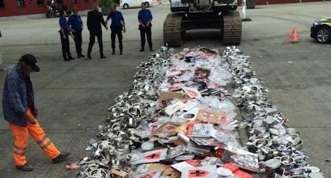 Border guards crush tonne of fake pots