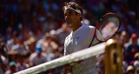 Federer and Nadal brush aside Wimbledon heat
