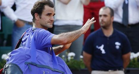 Federer preps for Wimbledon in Germany
