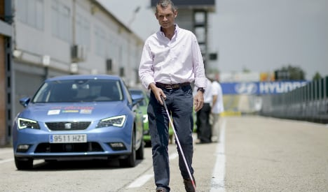 Blind drivers get behind the wheel on F1 track