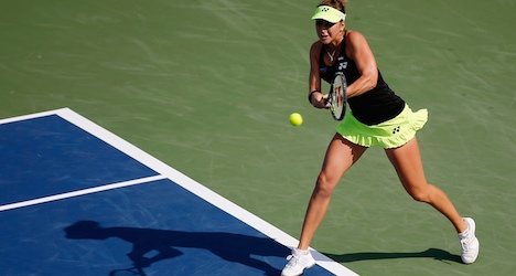 Rising Swiss star Bencic remains on a roll in US