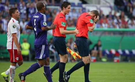 Attack on referee halts football match
