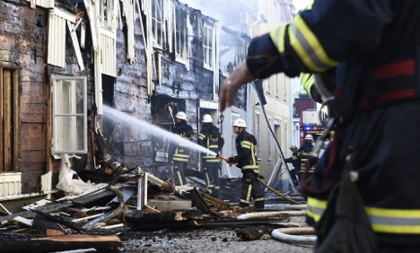 Wooden town resembles 'war zone' after huge fire